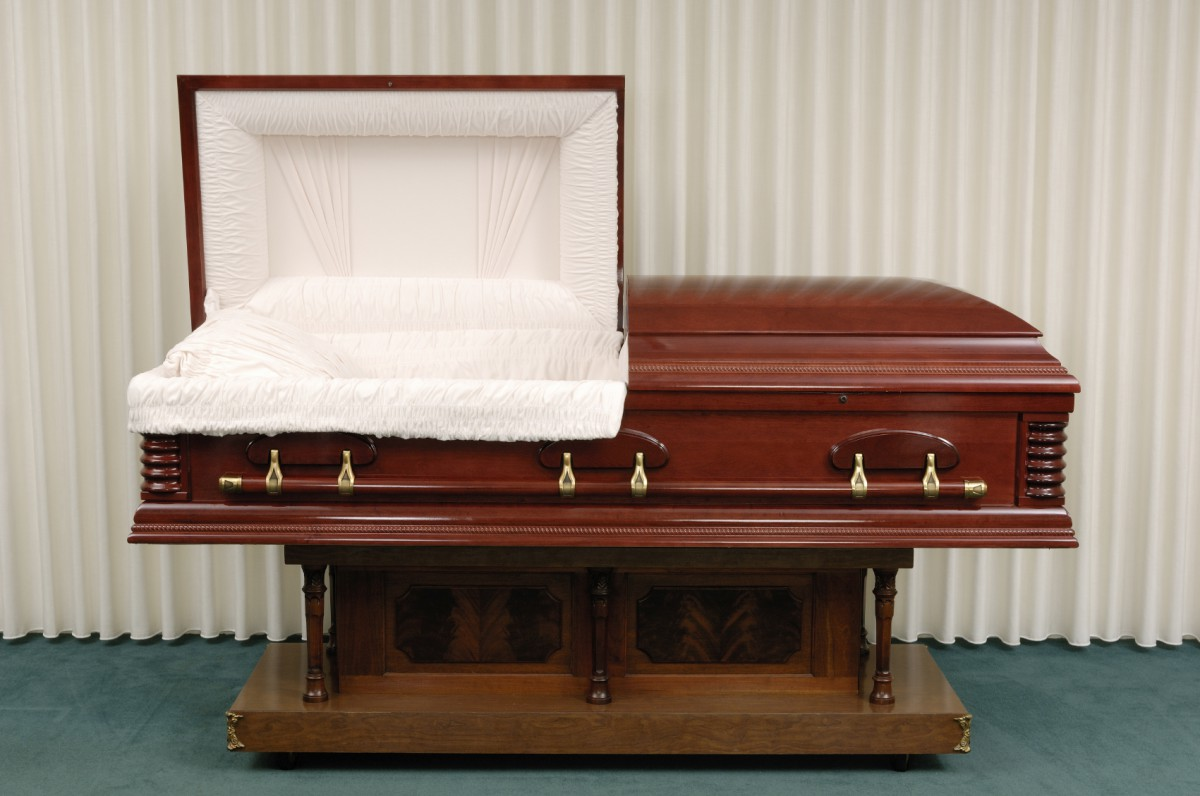 Wooden casket made of Cherry in a funeral home.