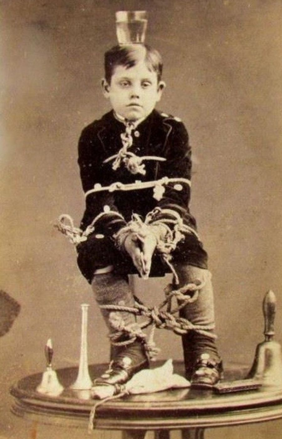 slipshod-child tied in chair