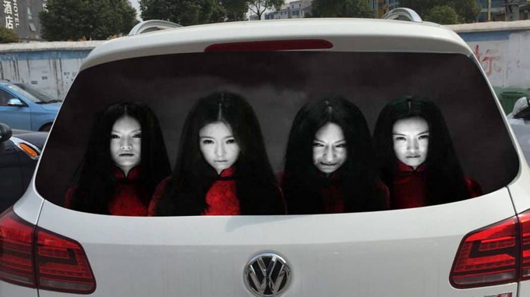 These scary window decal faces should discourage high beam usage